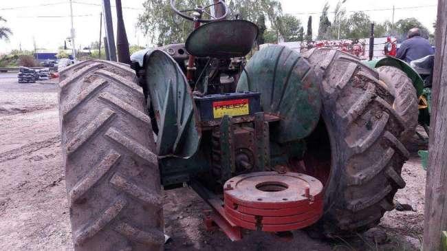 Excelente Tractor Pala