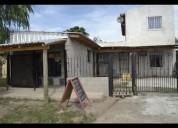 Casa con local y fondo de comercio