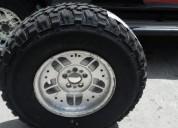 Excelente 4 cubiertas 31 y llantas para jeep