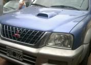 Vendo camioneta mitsubhisi l200 4x4 doble cabina m04