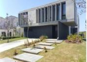 Hermosa casa de diseno minimalista a estrenar en el golf de nordelta 4 dormitorios