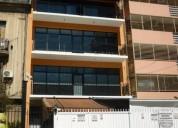 Departamento tipo casa en planta baja 4 ambientes y cochera 2 dormitorios