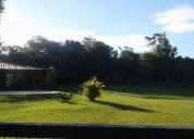 Casa quinta con pileta frente a la laguna totora 2 dormitorios