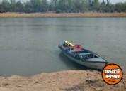 Canoa y motor barcos y lanchas, contactarse.