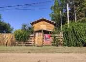 Cabana de troncos en pueblo liebig en colón