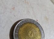 Moneda de 1 peso argentino con error provingia